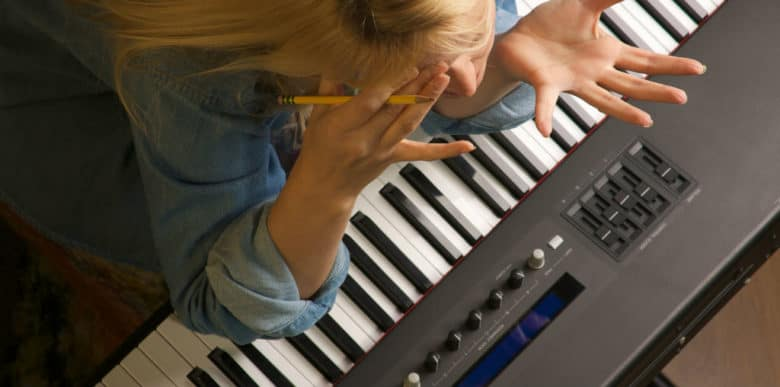 angry woman playing keyboard